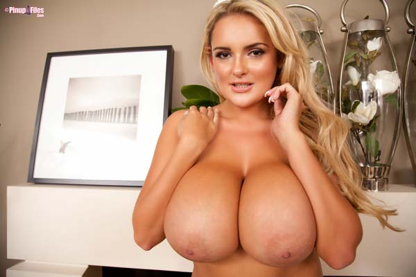 katie-thornton-playing-with-her-big-tits-by-the-chimney14