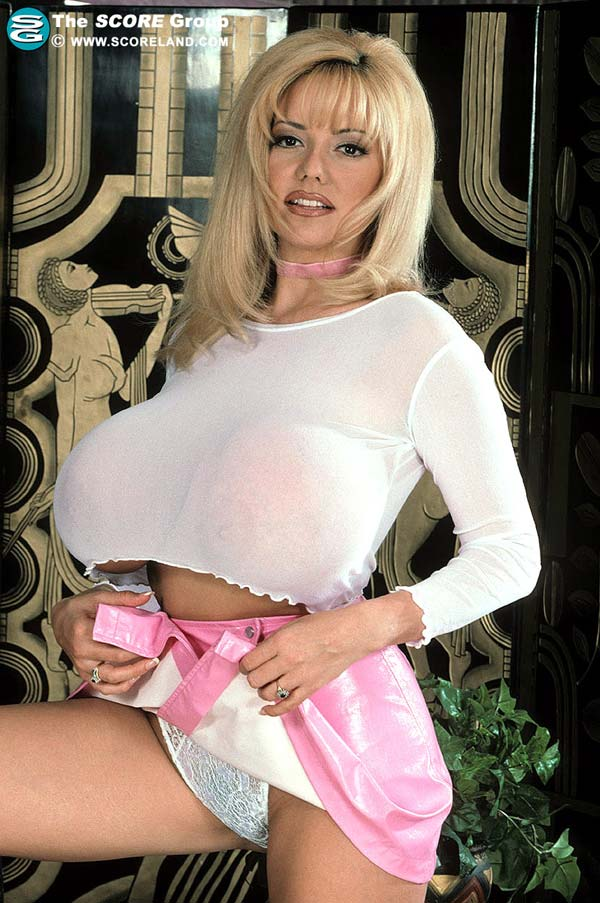 traci-topps-shows-her-huge-boobs-wearing-a-pink-skirt04