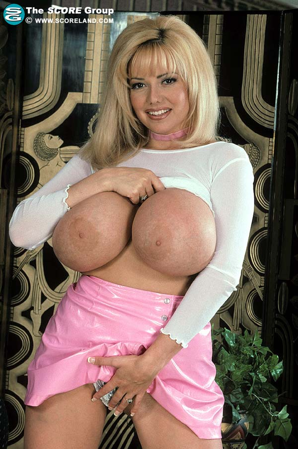 traci-topps-shows-her-huge-boobs-wearing-a-pink-skirt10