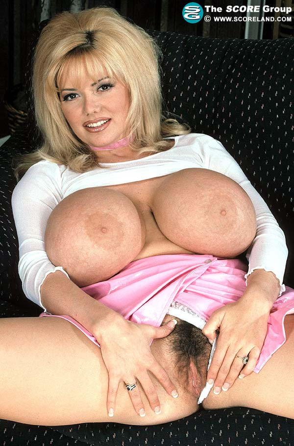 traci-topps-shows-her-huge-boobs-wearing-a-pink-skirt24