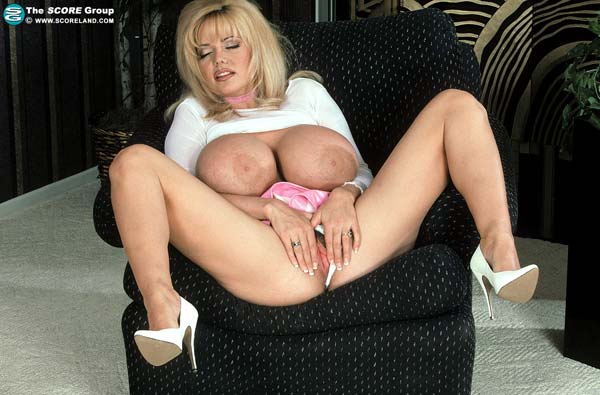 traci-topps-shows-her-huge-boobs-wearing-a-pink-skirt29