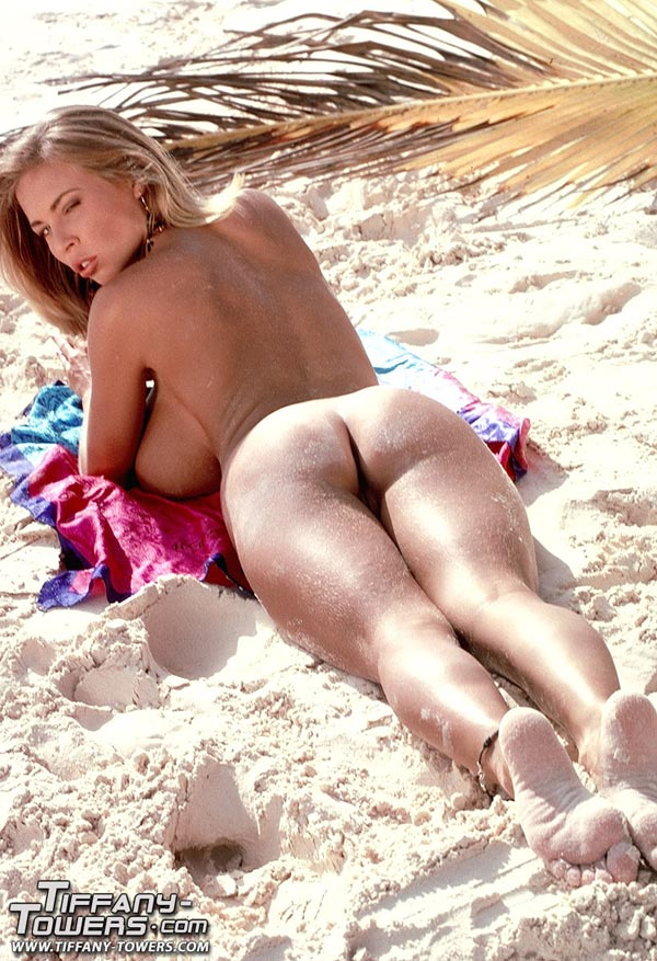 tiffany-towers-rolling-her-massive-tits-on-the-sand-4