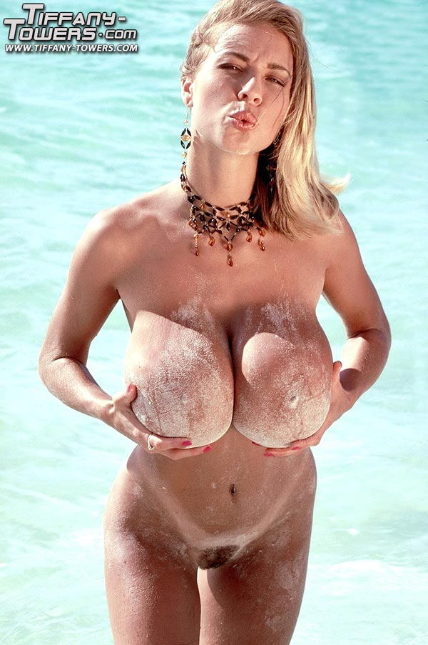 tiffany-towers-rolling-her-massive-tits-on-the-sand-53