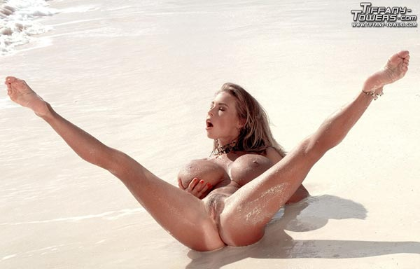 tiffany-towers-rolling-her-massive-tits-on-the-sand-58