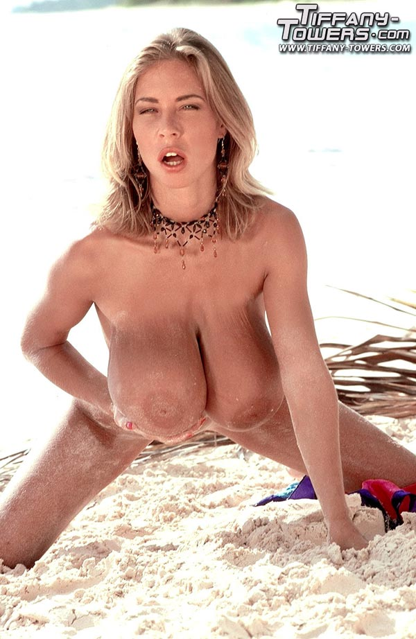 tiffany-towers-rolling-her-massive-tits-on-the-sand-65