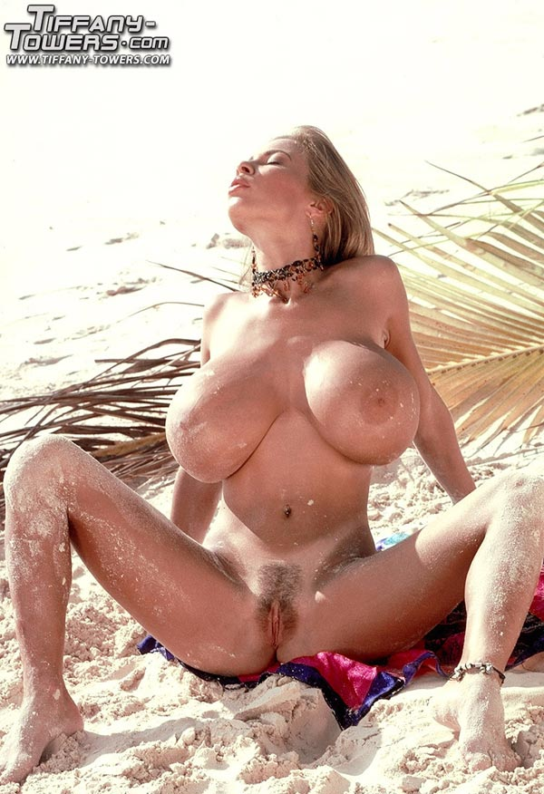 tiffany-towers-rolling-her-massive-tits-on-the-sand-68