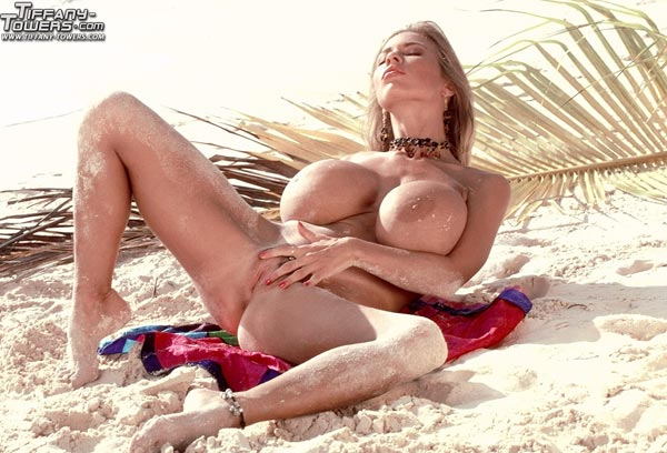 tiffany-towers-rolling-her-massive-tits-on-the-sand-71