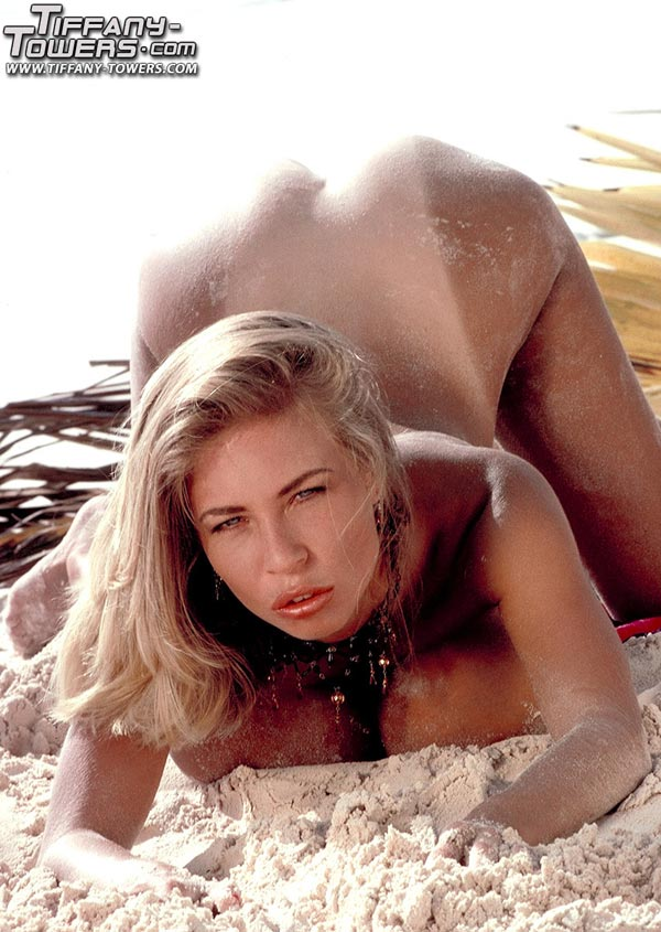 tiffany-towers-rolling-her-massive-tits-on-the-sand-79