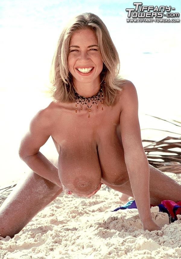 tiffany-towers-rolling-her-massive-tits-on-the-sand-80