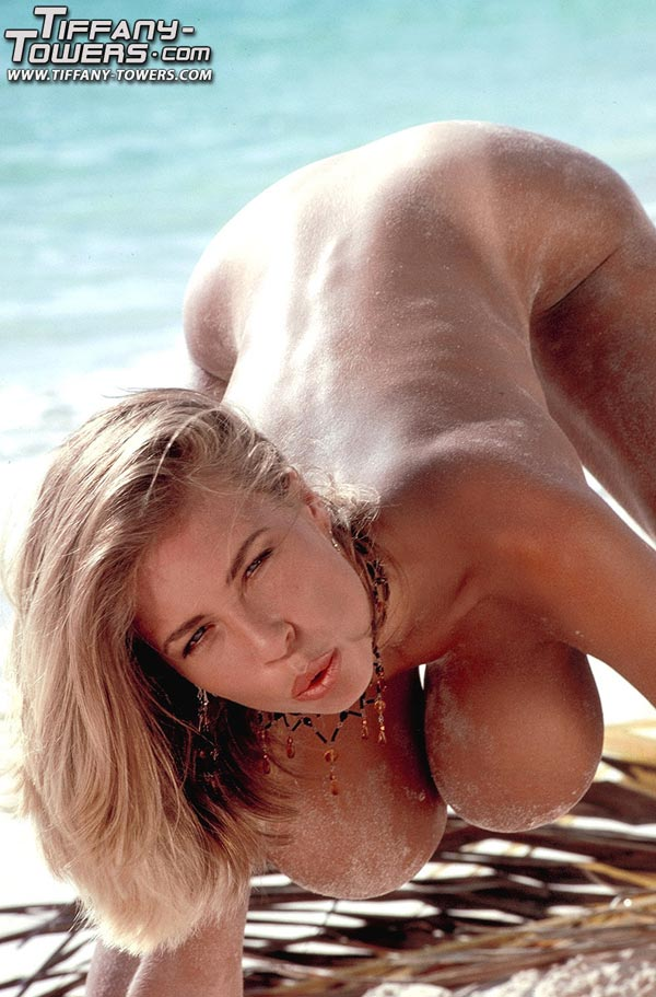 tiffany-towers-rolling-her-massive-tits-on-the-sand-87
