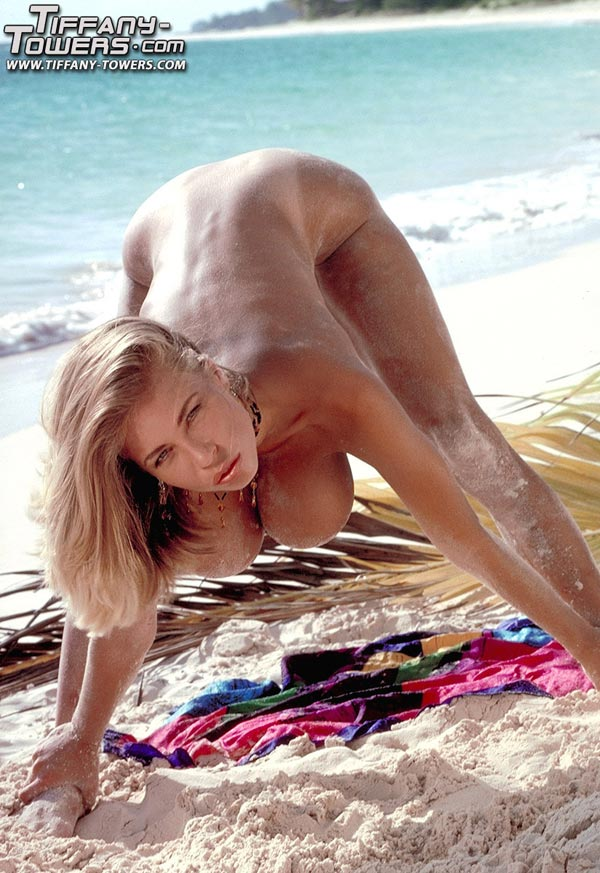 tiffany-towers-rolling-her-massive-tits-on-the-sand-98