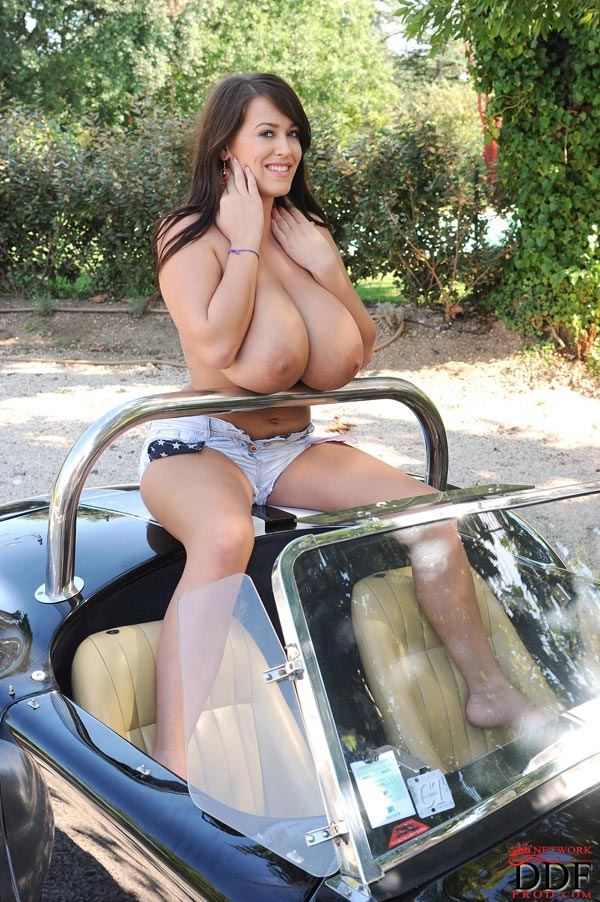 leanne-crow-exposing-her-massive-tits-next-to-a-classic-car_51009081