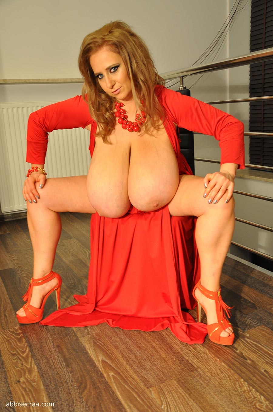 Abbi Secraa in a tight red dress  The Boobs Blog